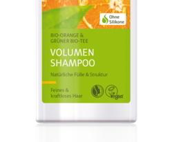 Das Natrue-Siegel und die Veganblume auf einem Shampoo